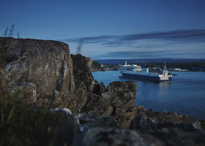 A Marine Atlantic ferry sails past the rocky granite coastline into the harbour at Port aux Basques,  Newfoundland.